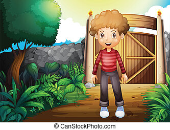 A smiling young boy inside the gated yard
