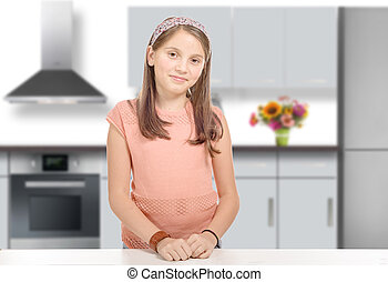smiling young girl in a kitchen