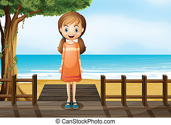 A smiling young girl standing at the wooden bridge