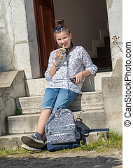 smiling young teen girl sitting on the steps