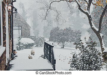 A Snow Covered Entryway to a Large Suburban Home