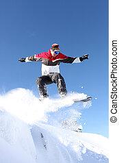 A snowboarder gliding through the air
