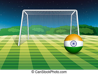 A soccer ball near the net with the flag of India