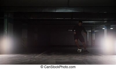 A soccer man leading the ball using feints and kicking it on...