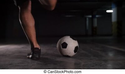 A soccer man runs to the ball and kicking it. Mid shot
