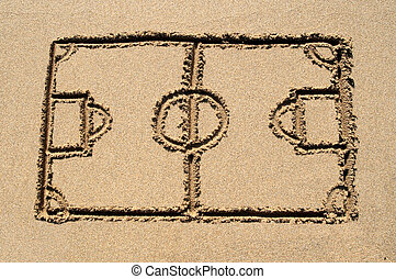 A soccer pitch drawn on a sandy beach.