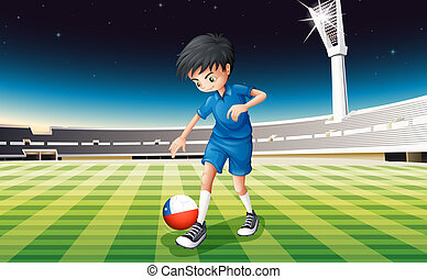 A soccer player at the field with the flag of Chile -...