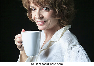 A social Woman with coffee smiling