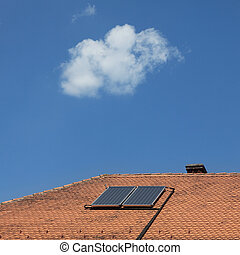 A solar collector on a roof of old house