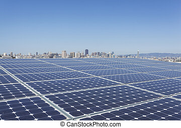 A solar panels on the rooftop of the building with San Francisco skyline in the background.