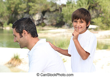 a son playing with his father