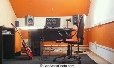 A sound recording studio interior. Mid shot