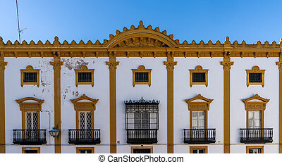 Spanish style architecture building in white and yellow in downtown Zafra