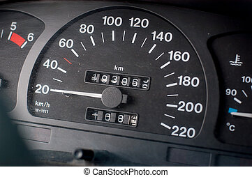 A speedometer of a car. Max speed 220 km/h