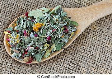 A spoon of dried Herbal tea