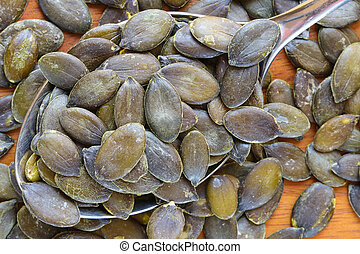 A spoon of roasted Pumpkin seeds