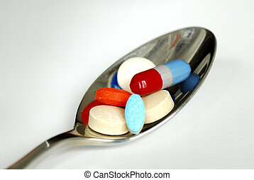 A spoonful of medicine including painkiller and vitamin