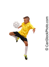 A sportive boy kicking a soccer ball. A little kid in a football uniform isolated on a white background. Sports concept.