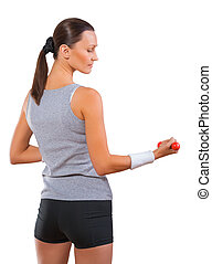 a sportswoman holding small dumbbell isolated