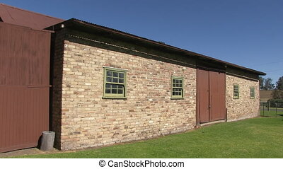 A stable made out of bricks - A steady shot of a stable in...