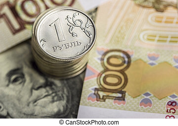 A stack of coins on the background of Russian money