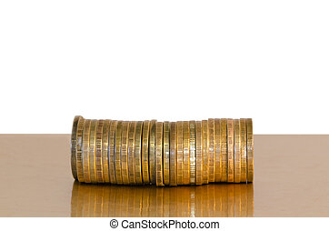 A stack of coins, placed horizontally on a white background