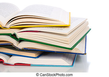 A stack of colorful, open books on a white background