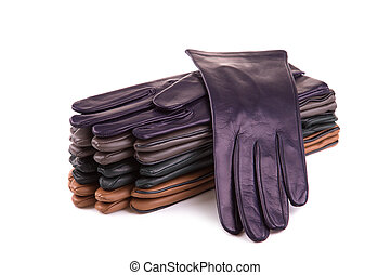 A stack of multi-colored leather gloves on a white background.