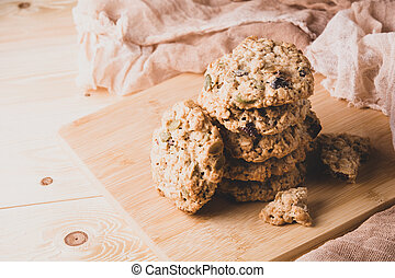 A stack of oatmeal cookies on a light background. Close-up.