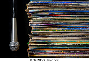 A stack of old records and hanging microphone