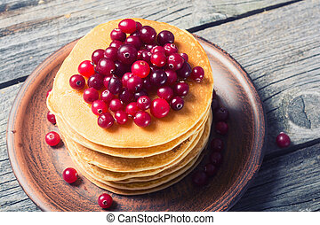 A stack of pancakes with cranberries