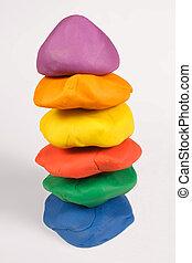 A stack of colorful plasticine.