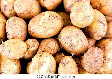 A stack of potatoes for sale in market