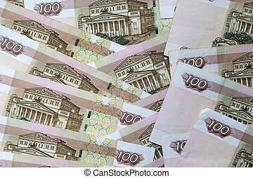 A stack of Russian banknotes of a hundred rubles close up. Money background