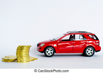 A stack of shiny yellow coins on a background of red car on a light gray background.