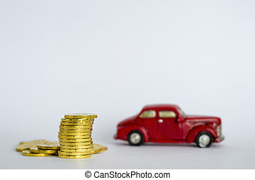 A stack of shiny yellow coins on a background of red retro car on a light gray background