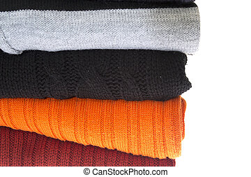 A stack of sweaters isolated on a white
