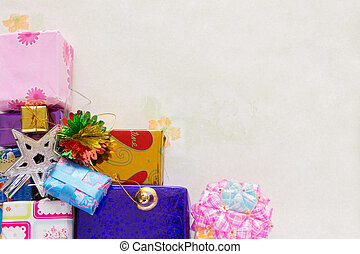 A stacking and decoration of present of holiday gifts over background