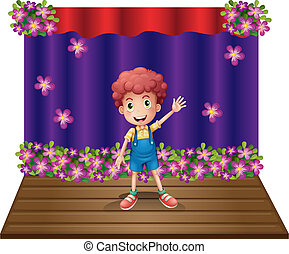 A stage with a young boy waving happily