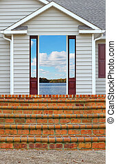 A staircase leading to a porch and a back door entrance to a...