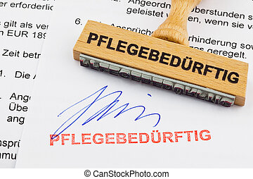 a stamp made of wood lying on a document. german inscription of care