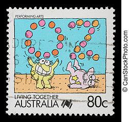 A stamp printed in Australia shows Performing arts jugglers...