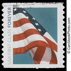 """A stamp printed in USA, Flag, """"usa first -class forever"""", ..."""