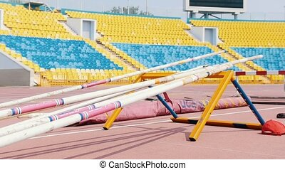 A stand in the stadium for the pole vault poles. Mid shot