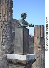 A Statue and Columns in Pompeii