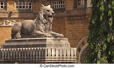 A statue of a lion rests in India - A wide static shot of a...