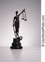 A statue of Themis on white background