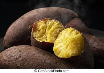 A steamy sweet potato split in half