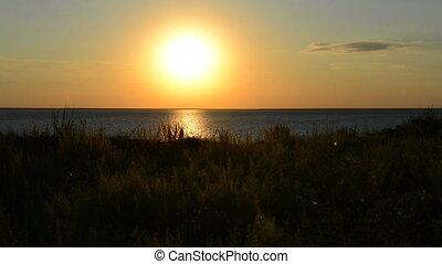 steep seashore  - a steep seashore is in the rays of sunset