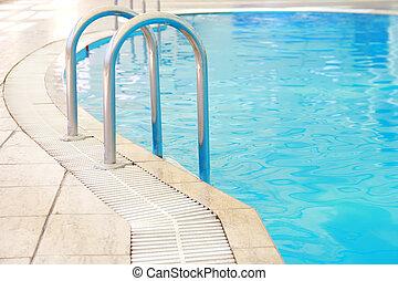 steps in a water pool - a steps in a water pool